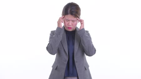 Stressed young Asian businesswoman having headache
