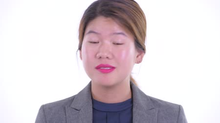 Face of serious young Asian businesswoman nodding head no
