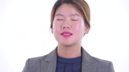 devanear : Face of happy young Asian businesswoman relaxing with eyes closed