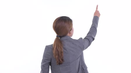 direkt : Rear view of young Asian businesswoman pointing finger and directing Stok Video