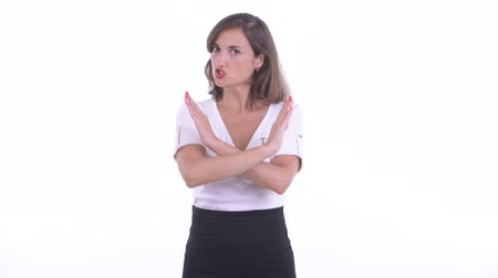 crossed : Serious businesswoman with stop gesture