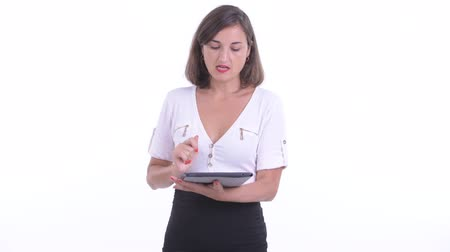 итальянский : Happy beautiful businesswoman talking while using digital tablet
