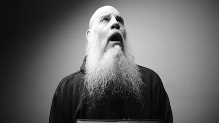 ilginç : Mature bald bearded man looking shocked with dramatic shot in black and white