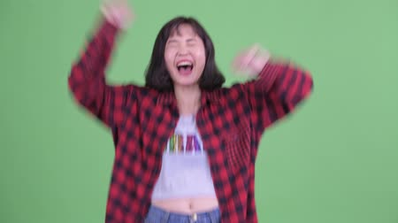 victoria : Happy Asian hipster woman getting good news Archivo de Video