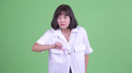 Angry Asian businesswoman giving thumbs down Dostupné videozáznamy