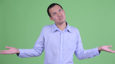 can sıkıntısı : Stressed Asian businessman looking bored and tired Stok Video
