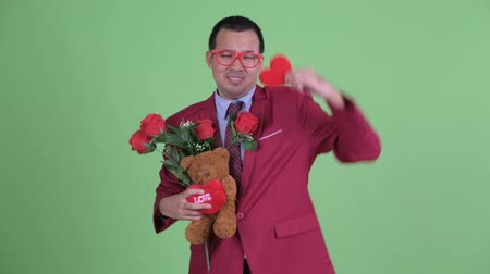 heart failure : Sad Asian businessman with eyeglasses depressed for Valentines day Stock Footage
