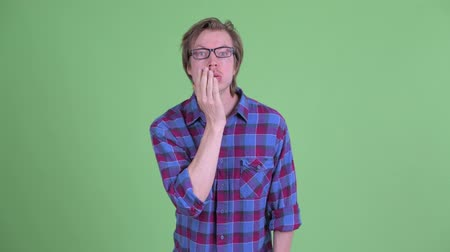 ashamed : Stressed young hipster man with face palm gesture