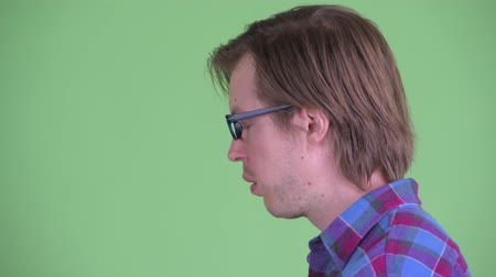 ashamed : Closeup profile view of stressed young hipster man with face palm gesture
