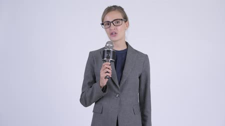 evsahibi : Young beautiful businesswoman as newscaster using microphone