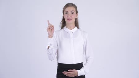 algo : Young happy pregnant businesswoman pointing up and talking Archivo de Video