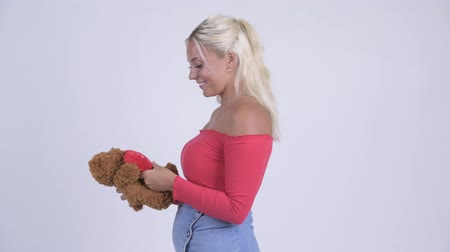 taken : Young beautiful blonde woman with teddy bear being taken away for Valentines day