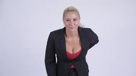 ból pleców : Young stressed blonde businesswoman having back pain