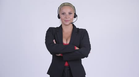 телемаркетинг : Young blonde businesswoman as call center representative with arms crossed