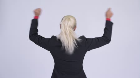 raising fist : Rear view of young happy blonde businesswoman with fists raised Stock Footage