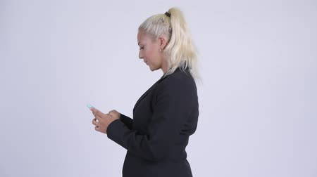 taken : Profile view of young blonde businesswoman with phone being taken away Stock Footage
