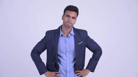 разочарование : Stressed young Indian businessman giving thumbs down