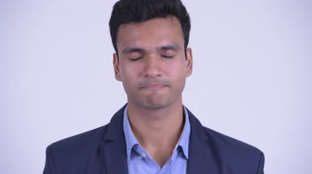 ukłon : Face of happy young Indian businessman nodding head yes