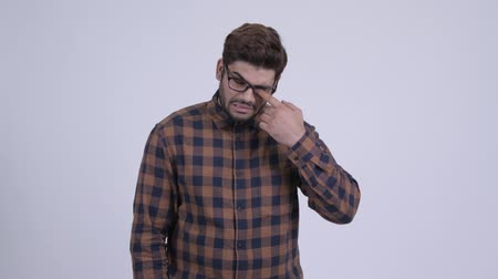 Happy young bearded Indian hipster man smiling and waving hand Wideo