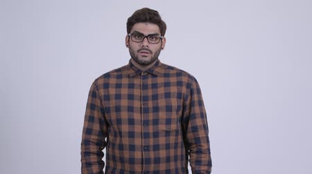 Young bearded Indian hipster man thinking Wideo