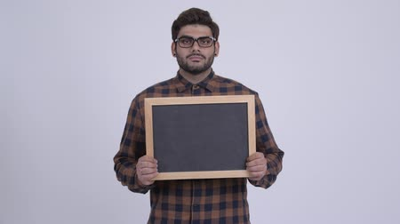 콧수염 : Happy young bearded Indian hipster man holding blackboard