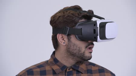 Young bearded Indian hipster man using virtual reality headset Wideo