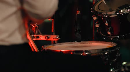baqueta : Hands drummer closeup playing on a drum set at a rock concert.