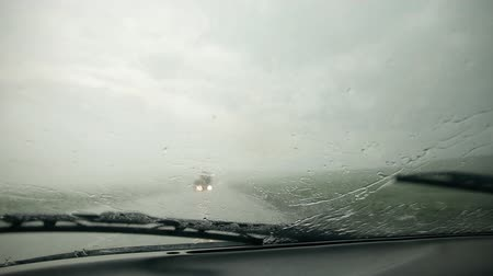 mirror glass : The car rides on the highway during heavy rain. Stock Footage