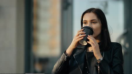 портфель : Young attractive woman drinking coffee. Стоковые видеозаписи
