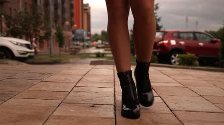 emancipation : Close-up of the legs of a young woman walking around the city