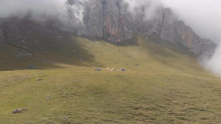 alpinism : Aerial shot of a camp of climbers in the mountains among the clouds.