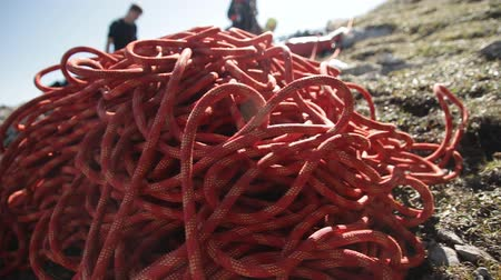 karabély : Climbing rope closeup. Equipment climbers in the mountains, steadicam shot.