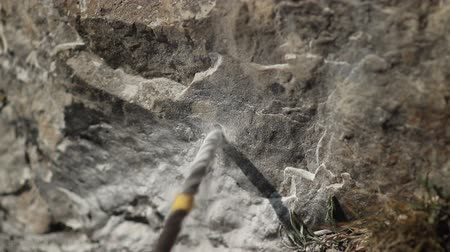 destroyer : Close-up of the hammer drill a hole in the rock. Stock Footage