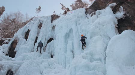 góral : Krasnoyarsk, Russia - 14 Jan, 2017: Competition climbers on the frozen waterfall in the nature reserve Stolby