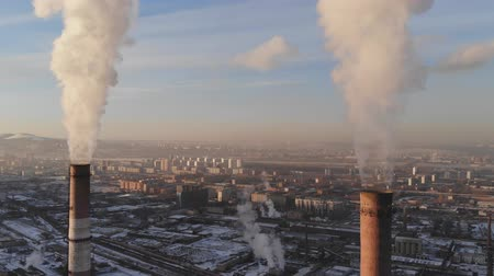 dioxid : Aerial view of smoke rising from the chimney of a coal boiler. Dolly zoom effect. Stock mozgókép