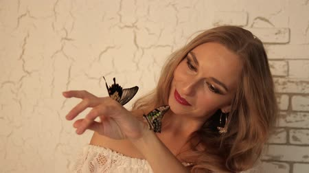 хрупкость : Young woman with butterflies on her hands.