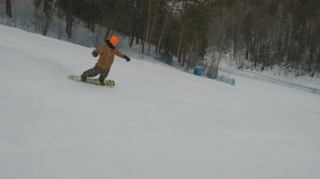 A young man snowboarding.