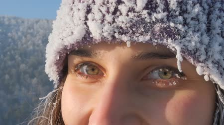 иней : Close-up of the eyes of a happy young woman in winter.