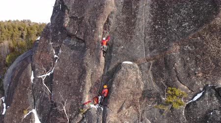 fearless : Two climbers climb the wall at high altitude.