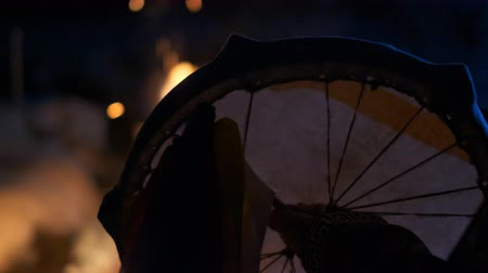 kultusz : The silhouette of a shamans tambourine near the fire. Stock mozgókép