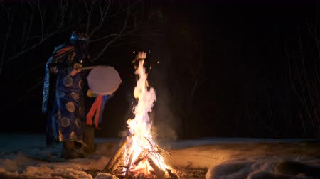 shaman : The shaman is dancing a ritual dance near the fire. Stock Footage