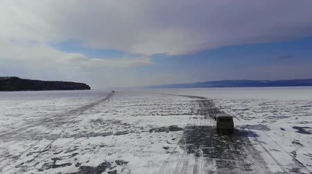 Car driving on ice road of lake Baikal