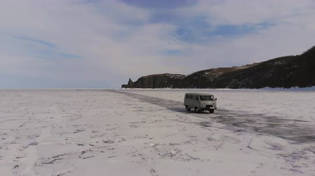 Car driving on frozen lake. Стоковые видеозаписи