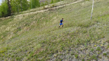 A man runs up the mountainside.