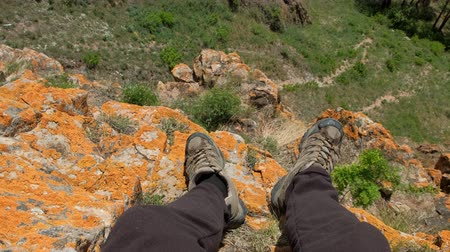 Close up hiking boots of man traveller on top of mountain. POV