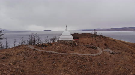 пробуждение : Panorama of the island of Ogoy in cloudy weather. Buddhist stupa on lake Baikal.