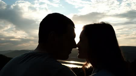 parte : Young couple kissing noses and smiling at sunset. Stock Footage