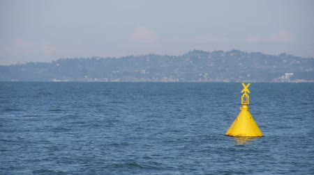 yelow : Buoy in black sea, Georgia, Batumi.