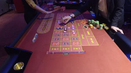 složka : Croupiers And Players Make Bets In Casinos