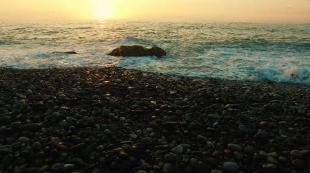 Rocky seashore at sunset, sunset at sea in Batumi, Georgia Dostupné videozáznamy